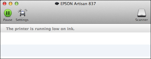 What's the yellow triangle on my printer icon mean? - Ask