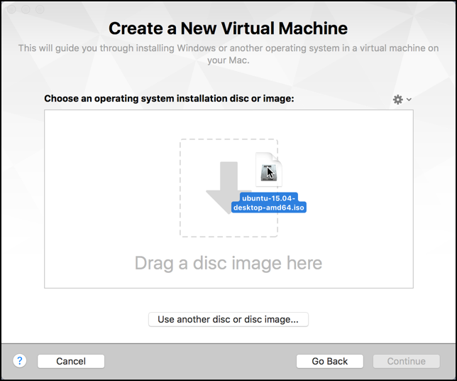 drag an ISO disk image onto VMware Fusion to start the install process