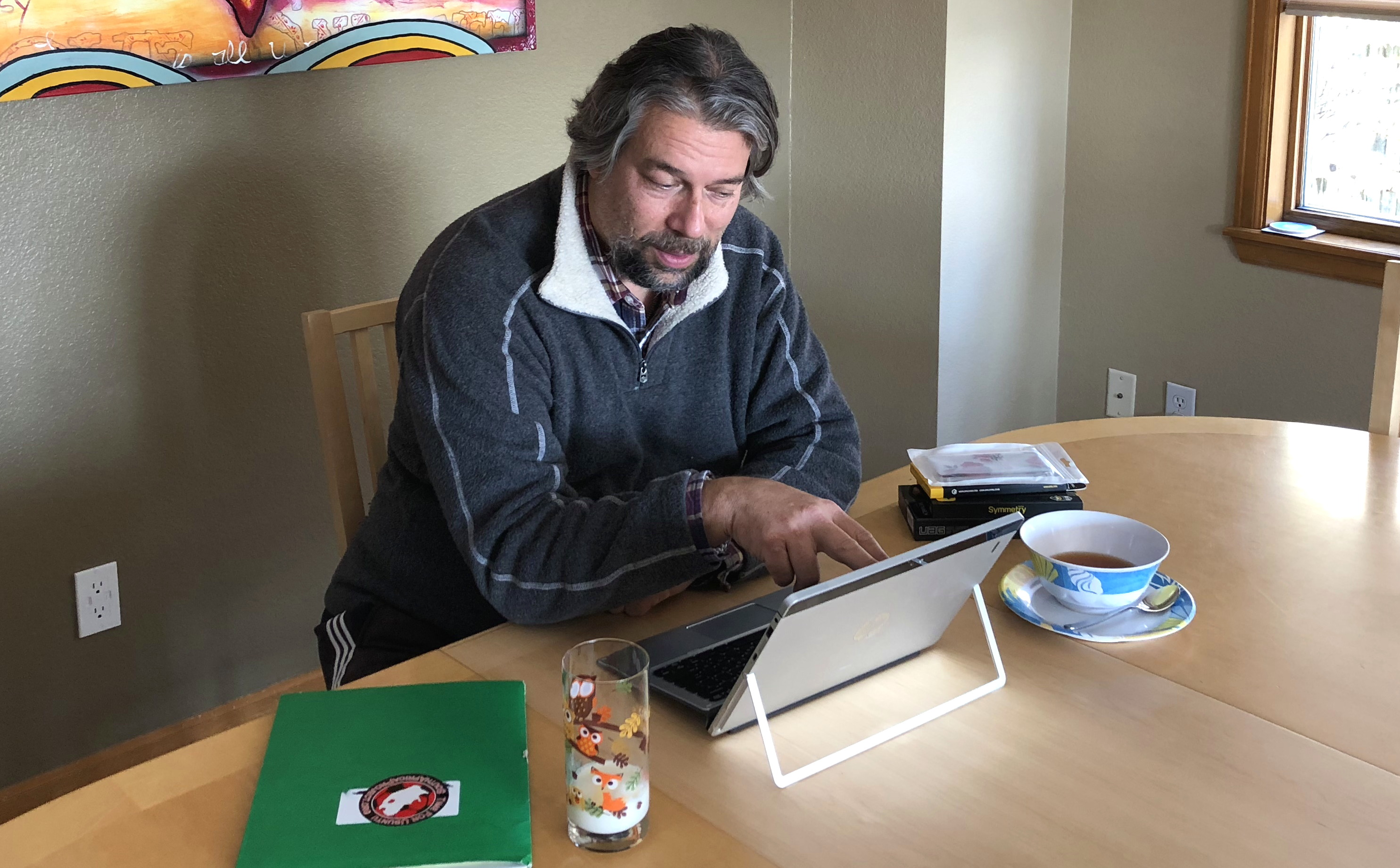 man working at dining table office desk