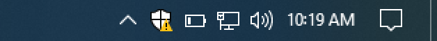 taskbar with windows defender warning