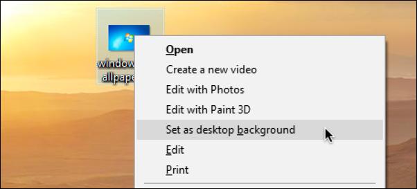 right click on image file > set as desktop wallpaper windows 10