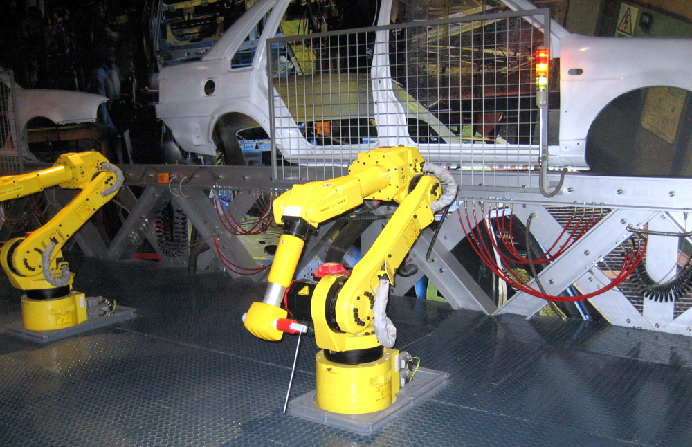 robot worker car assembly line