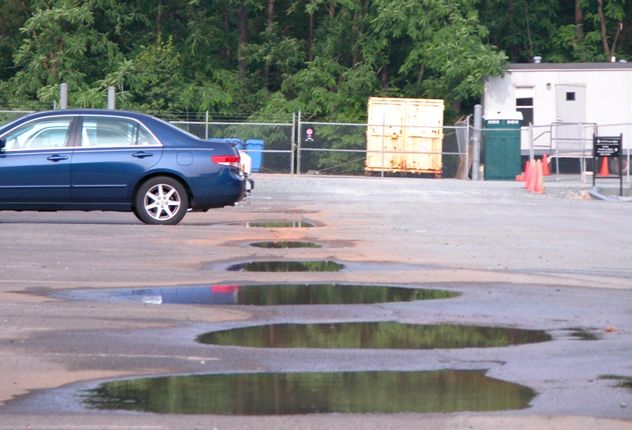 parking lot with puddles - wikimedia commons