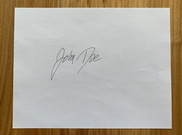 sample signature on sheet of paper - john doe