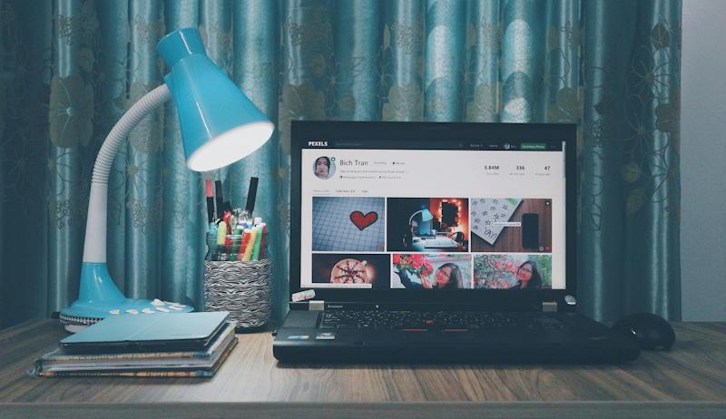 laptop with desktop lamp