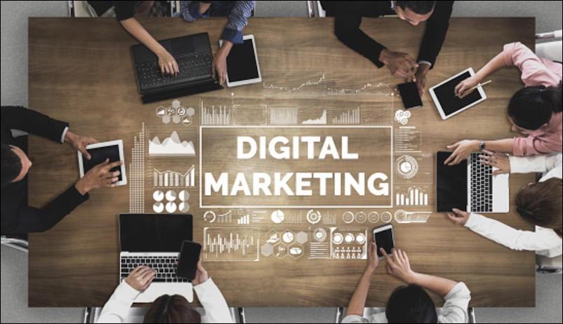 people sitting around desk 'digital marketing'