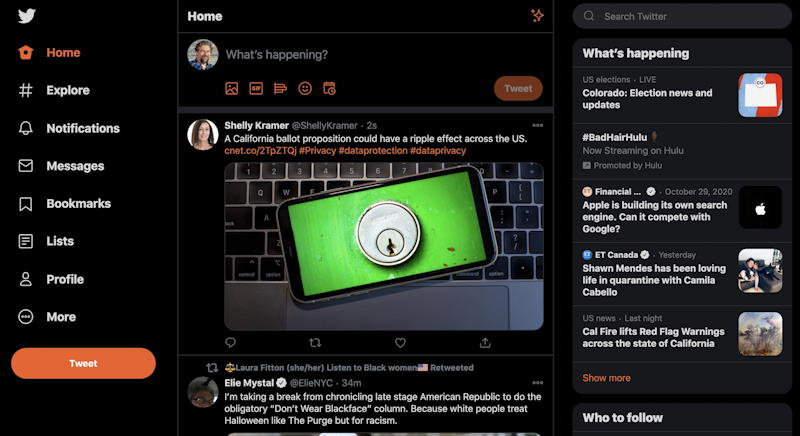twitter.com home page view dark theme lights out black orange highlights