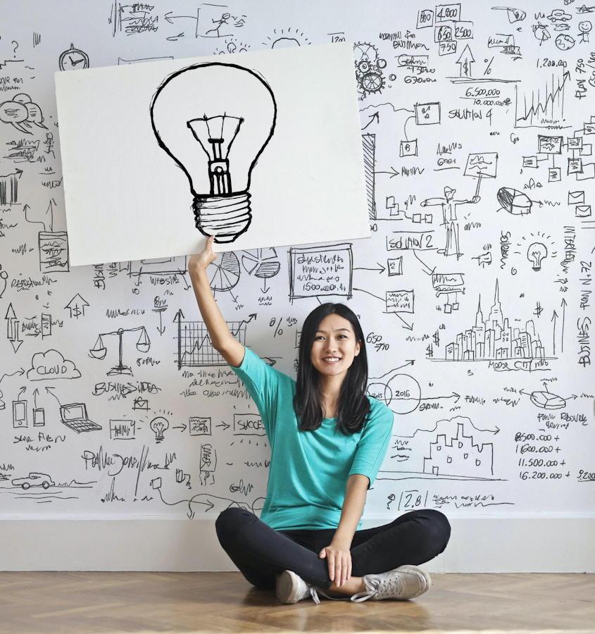 woman idea light bulb marketing