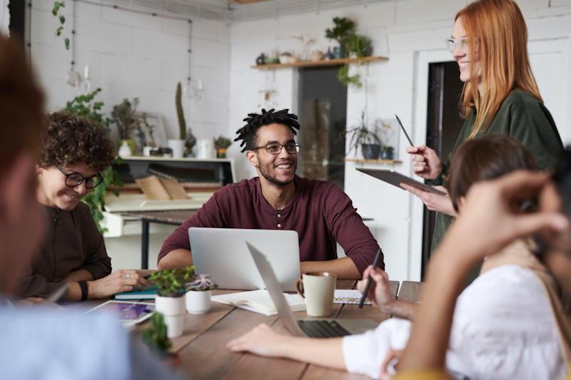 people millennials meeting laptop computer