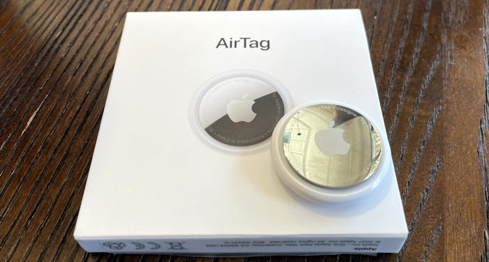 apple airtag on top of box