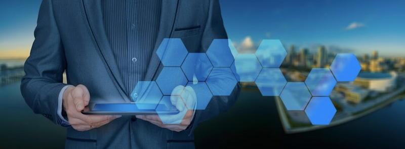 man holding laptop, blue hexagons