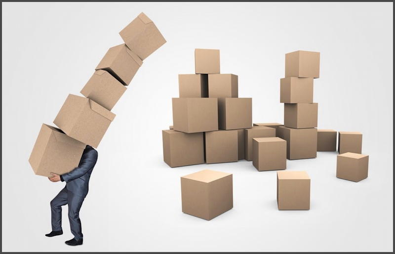 supply chain - man carrying boxes